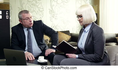 Daily Plans - Businessman planning his day, his secretary...