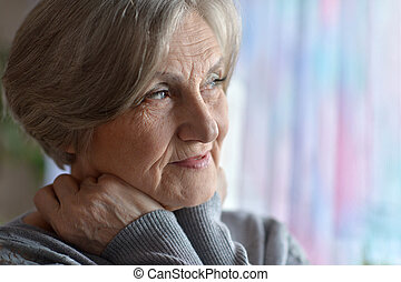 Elderly woman in the room