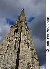 Church Spire - Tall church spire against blue sky and...
