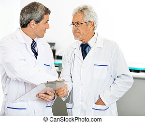 Researchers Shaking Hands - Male researchers shaking hands...