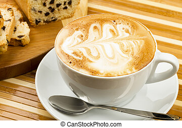 cup of cappucino and cakes on wooden background