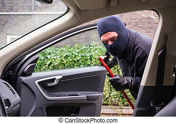 Car burglar in action - A burglar in action to rob something...
