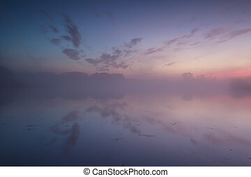 warm misty sunrise in summer over river - calm, warm misty...