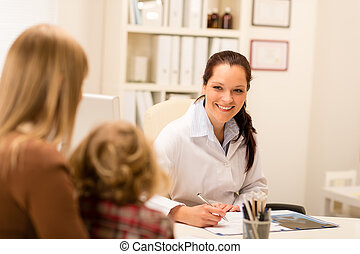 Mother and child girl visit pediatrician office healthcare...