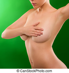 Woman cover naked breasts beautiful silhouette on green...