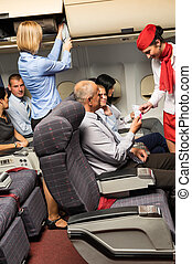 Flight attendant check passenger tickets cabin - Flight...