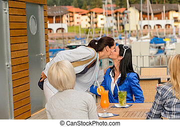 Woman leaving from outdoor restaurant terrace - Woman saying...
