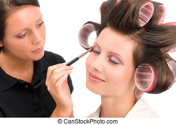 Make-up artist woman fashion model apply eyeshadow with...