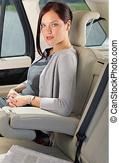 Executive woman manager sitting in car backseat - Executive...