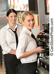 Smiling young waitresses serving coffee restaurant - Smiling...