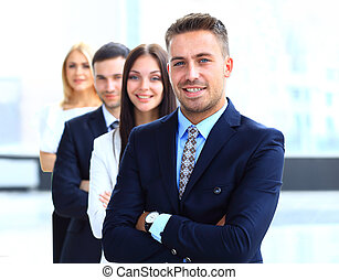 Smiling business people standing together in line in a...