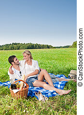 Picnic - Romantic couple in sunny meadows - Picnic -...