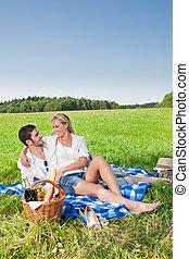 Picnic - Romantic couple in sunny meadows - Picnic -...