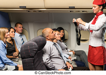 Flight attendant demo fastening seat belt airplane - Flight...