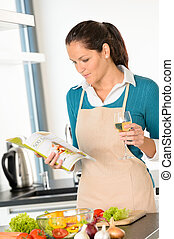Caucasian woman preparing vegetables recipe kitchen cooking...