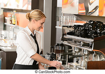 Waitress preparing hot beverage in coffee house - Smiling...