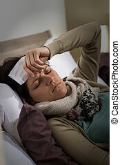 Young ill woman having high fever flu - Young ill woman in...