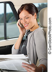 Executive woman manager sitting in car calling - Attractive...