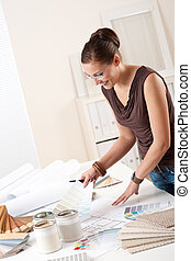 Young female designer at office with color swatches - Young...
