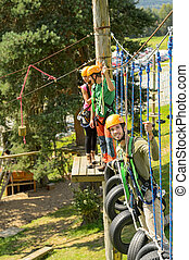 Climbing visitors in adventure park - Adventure park...