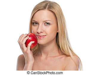 Portrait of young woman with apple