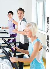 Fitness young people on treadmill running exercise - Walking...