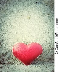 leather heart on sand for valentine day
