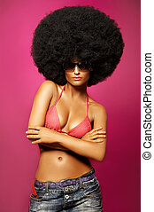 Afro Girl - Beautiful woman with huge afro haircut on pink