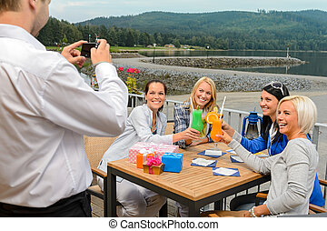 Woman posing for camera at restaurant outdoors - Cheerful...