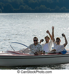 Cheerful young men drink beer speed boat - Cheerful young...