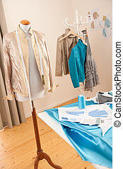 Fashion designer studio with professional equipment,...