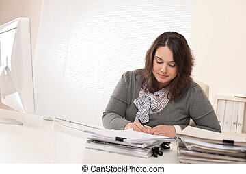 Young businesswoman working at office with computer