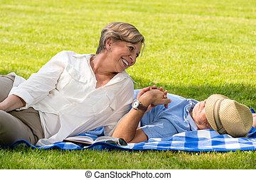 Elderly couple enjoying relax time in park