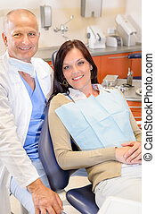 Dentist and female patient at surgery office