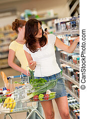 Shopping series - Beautiful brunette in a supermarket -...