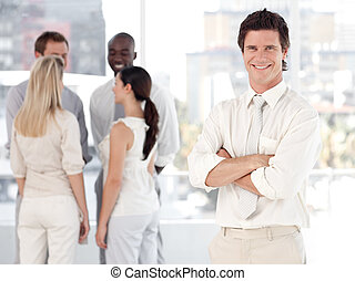 Young Business man Smiling in Front of Business team -...