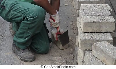 Construction worker cleaning bricks - construction worker,...