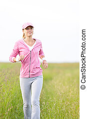 Jogging sportive young woman running park field - Jogging...