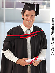 Man Graduating from University - Young ManGraduating from...