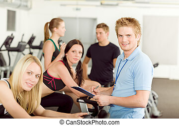 Young fitness instructor gym people spinning - Young fitness...