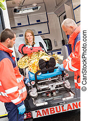 Patient secured in stretcher ambulance paramedics -...