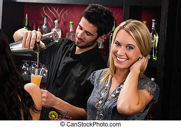 Attractive blond girl at cocktail bar smiling - Young happy...