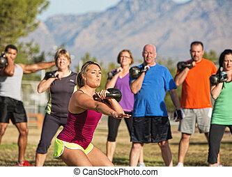 Mixed Group of People Exercising