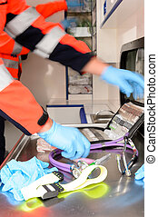 Rushing paramedics with medical equipments - Paramedics in a...