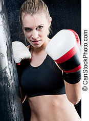 Boxing training woman with gloves in gym - Blond training...