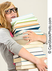 Worried student girl carry stack of books wear glasses
