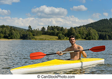 Sporty man in kayak with oar summer - Young sportsman...