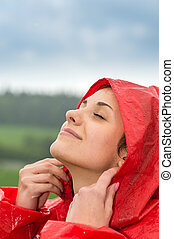 Portrait of young girl feeling the rain - Portrait of young...