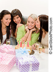 Birthday party - group of woman celebrate with cake and...