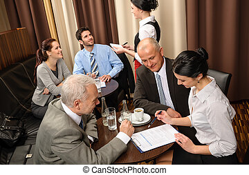 Business meeting executives dealing at restaurant - Business...